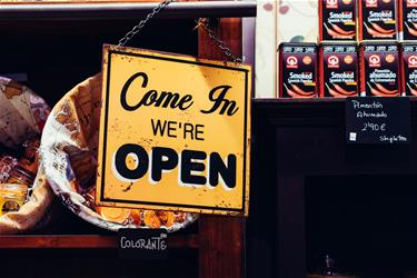 Come on in, we're open sign.
